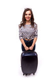 Full length of young female in casual walking with the travel bag Stock Photo