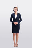 Full length of a young female customer service operator.  Stock Photo