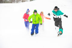 Full length of young friends having fun in snow royalty free stock images