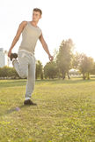 Full length of young man exercising in park Royalty Free Stock Image
