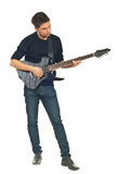 Full length of young man with guitar Royalty Free Stock Image