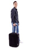 Full length of young man holding his luggage Royalty Free Stock Photos