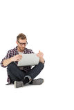 Full length of a young man with laptop Stock Photography
