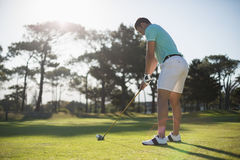 Full length of young man playing golf. While standing on field Stock Photo