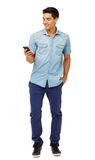 Full Length Of Young Man Reading Text Message Stock Photography