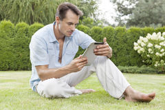 Full length of young man using digital tablet in park Stock Images