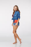 Full length of young stylish slim tanned female in denim shorts Royalty Free Stock Image