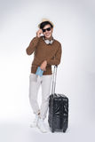 Full length of young tourist asian man holding passport with sui Royalty Free Stock Photography