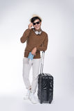 Full length of young tourist asian man holding passport with sui Stock Photo