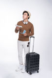 Full length of young tourist asian man holding passport with sui royalty free stock photo