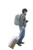 Full length of young traveler with suitcase and camera Royalty Free Stock Photo