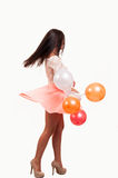 Full length young woman with balloons as a present for birt Royalty Free Stock Photography