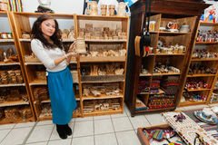 Full length of young woman displaying product in gift store Stock Images