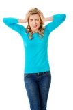 Full length young woman with huge headache Royalty Free Stock Photography