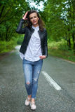 Full length of a young woman outdoor Stock Photography