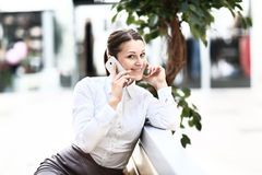Full length of young woman with phone Royalty Free Stock Photo