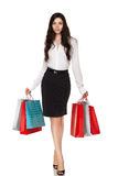 Full length of young woman with shopping bags Royalty Free Stock Image