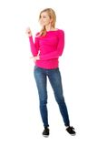 Full length young woman smiling Stock Photography