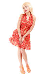Full lengthbeautiful pinup girl in blond wig retro red dress. Vintage. Royalty Free Stock Images