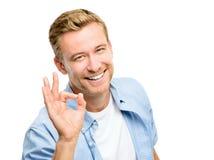 Full längd för attraktivt godkännande för ung man på vit bakgrund Arkivbilder