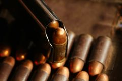 Bullet in magazine scene. The full load of old and dirty spare pistol bullet put in the socket of pocket represent the weapon and bullet concept related idea Royalty Free Stock Photos