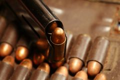 Bullet in magazine scene. The full load of old and dirty spare pistol bullet put in the socket of pocket represent the weapon and bullet concept related idea Royalty Free Stock Images
