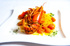 Full lobster with spaghetti on white plate Stock Photography