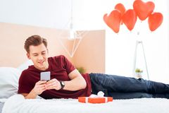 Joyful guy reading love message from girlfriend Royalty Free Stock Photo