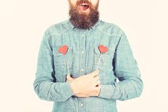 Full of love concept. Brutal man with long beard and open mouth is full of love.  royalty free stock images