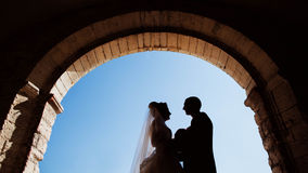 Full of love stylish groom with luxury blonde bride on the background the old castle stock images