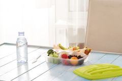 Full lunch box of healthy food on wooden table Royalty Free Stock Image