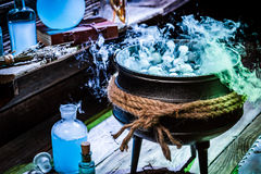 Full of magic mixture witch pot with blue smoke for Halloween Stock Image