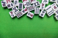 Full of Mahjong tiles on green background Royalty Free Stock Photos