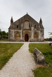 Full main entrance view of Aulnay de Saintonge church. In Charente Maritime region of France Stock Image