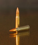 Full metal jacket bronze projectile Stock Photo