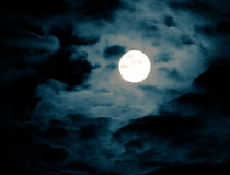 Full Moon. Photograph of the moon on a cloudy night Royalty Free Stock Images