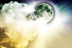 Full moon. And clouds with light rays stock images