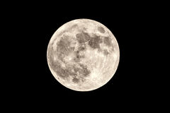 Full moon. Image of a full moon isolated on the dark background Stock Photography