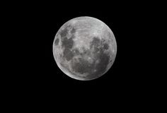 Full Moon. A full moon on a black night sky background viewed from the southern hemisphere Royalty Free Stock Images