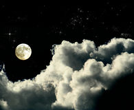 Full moon. Is ina deep sky full of clouds, copy space for messages royalty free stock image