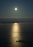 Full moon. Over the ocean with moon path Royalty Free Stock Photography