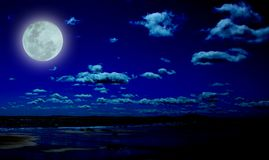 Full moon. At low tide royalty free stock images