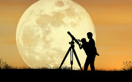 Full Moon. Two people exploring the astronomy life Royalty Free Stock Photo