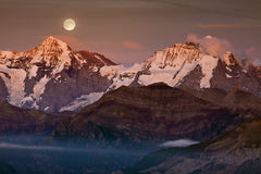 Full moon above alp Stock Image