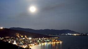 Full moon above the city with lake Royalty Free Stock Photos