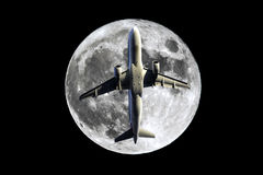 Full Moon airplane stock photography