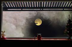 Full moon with bat and smoke in the window. Full moon with bat and mystery smoke  in the window frame in the night Royalty Free Stock Photography