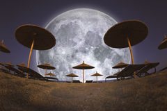 Full Moon and Beach Umbrellas Stock Photography