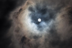 Full moon behind the clouds Royalty Free Stock Image