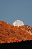 Full moon behind mountain. In scenic Alberta Royalty Free Stock Image